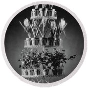 Potted Flowers On A Wrought Iron Stand Round Beach Towel