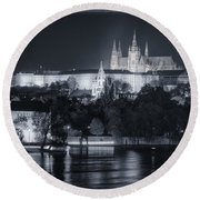 Prague Castle At Night Round Beach Towel by Joan Carroll