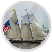 Pride Of Baltimore II Passing By Fort Mchenry Round Beach Towel