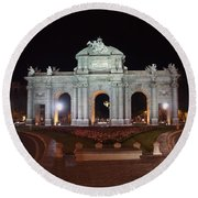 Puerta De Alcala At Night Round Beach Towel