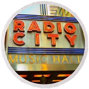 Round Beach Towel featuring the photograph Radio City Music Hall by Judy Palkimas