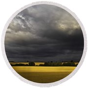 Rapefield Under Dark Sky Round Beach Towel