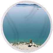 Rear View Of A Person Fishing Round Beach Towel