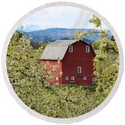 Round Beach Towel featuring the photograph Red Barn And Apple Blossoms by Patricia Babbitt