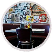 Red Booth Awaits In The Diner Round Beach Towel by Nina Prommer