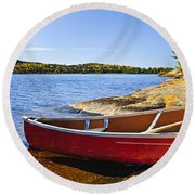 Red Canoe On Shore Round Beach Towel