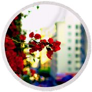 Round Beach Towel featuring the photograph Red Flowers Downtown by Matt Harang