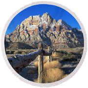 Round Beach Towel featuring the photograph Red Rock Snow by Alan Socolik