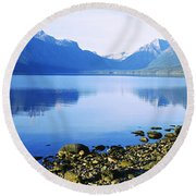 Reflection Of Rocks In A Lake, Mcdonald Round Beach Towel
