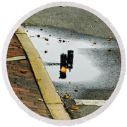 Reflection Of Traffic Light In Street Puddle Round Beach Towel by Gary Slawsky