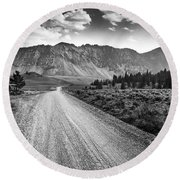 Riding To The Mountains Round Beach Towel