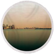 River With The City Skyline And Statue Round Beach Towel