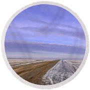 Road And Fild In Winter Time In Saskatchewan Round Beach Towel
