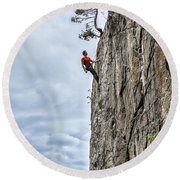 Round Beach Towel featuring the photograph Rock Climber by Carsten Reisinger