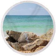 rocks in front of the Indian Ocean Round Beach Towel