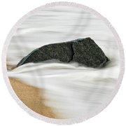 Surf Caresses A Lonely Stone Round Beach Towel by Gary Slawsky