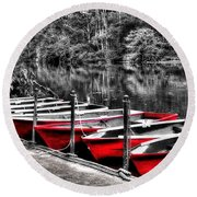 Row Of Red Rowing Boats Round Beach Towel
