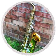 Saxophone Against Brick Round Beach Towel