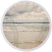 Seagulls Take Flight Over The Sea Round Beach Towel