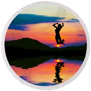 Silhouette Of Happy Woman Jumping At Sunset Round Beach Towel