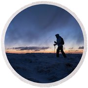 Silhouette Of Hiker On Wintry Summit Round Beach Towel