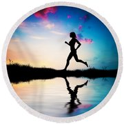 Silhouette Of Woman Running At Sunset Round Beach Towel