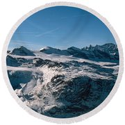 Skiers On Mountains In Winter Round Beach Towel