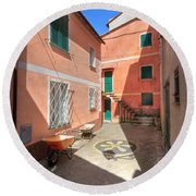 small square in Camogli Round Beach Towel