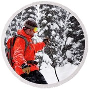 Smiling Male Skier On A Snowy Landscape Round Beach Towel