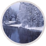Snow Covered Trees Along A River Round Beach Towel
