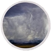 Snow On The Rockies Round Beach Towel by Greg Reed