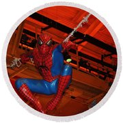Spiderman Swinging Through The Air Round Beach Towel