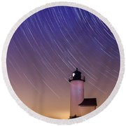 Stars Trailing Over Lighthouse Round Beach Towel by Jeff Folger