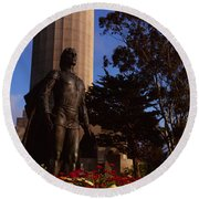 Statue Of Christopher Columbus In Front Round Beach Towel
