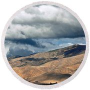 Storm Clouds Floating Above Mountains Round Beach Towel by Susan Wiedmann