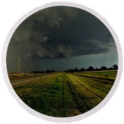 Round Beach Towel featuring the photograph Stormy Road Ahead by Ed Sweeney