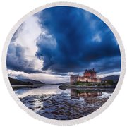 Stormy Skies Over Eilean Donan Castle Round Beach Towel