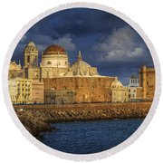 Stormy Skies Over The Cathedral Cadiz Spain Round Beach Towel