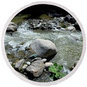 Round Beach Towel featuring the photograph Stream Water Foams And Rushes Past Boulders by Imran Ahmed