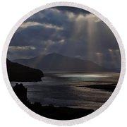 Sun Rays Over Eilean Donan Castle Round Beach Towel