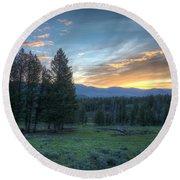 Sunrise Behind Pine Trees In Yellowstone Round Beach Towel