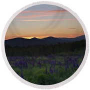 Sunrise Over A Field Of Lupines Round Beach Towel