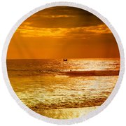 sunset in gold and red at the Hikkaduwa beach Round Beach Towel
