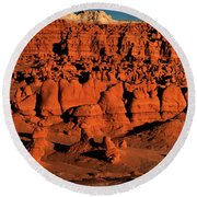Round Beach Towel featuring the photograph Sunset Light Turns The Hoodoos Blood Red In Goblin Valley State Park Utah by Dave Welling