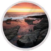 Sunset Over Rocky Coastline Round Beach Towel