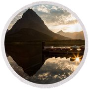 Swiftcurrent Lake Boats Reflection And Flare Round Beach Towel