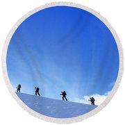 Team Of Telemark Skiers Ascending Round Beach Towel