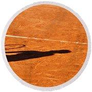 Tennis Player Shadow On A Clay Tennis Court Round Beach Towel