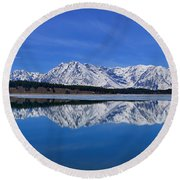 Teton End Of Winter Reflections Round Beach Towel