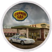The Corner Gas Station From The Canadian Tv Sitcom Round Beach Towel